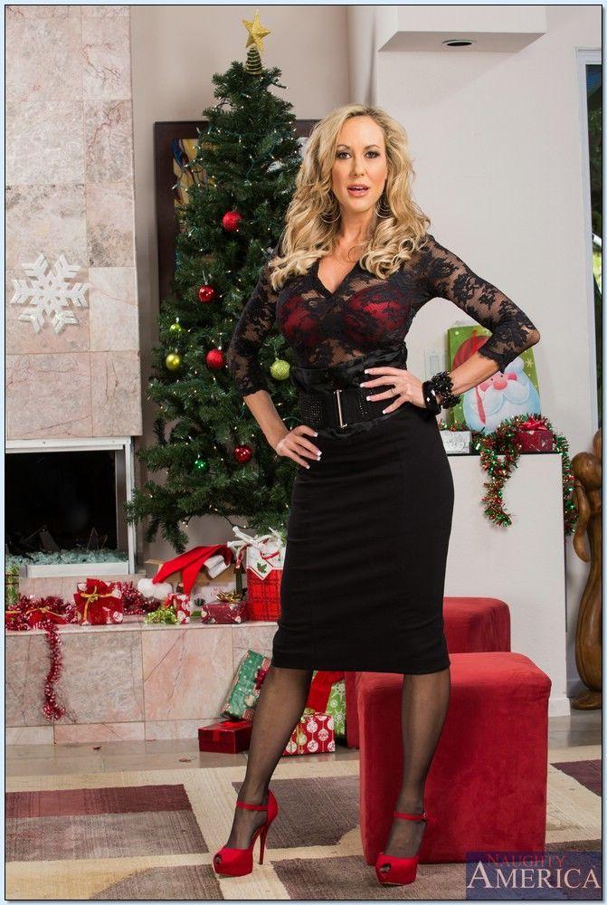 Hot MILF in stockings Brandi Love slipping off her suit